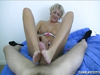 Mature sure likes pleasing the young pauper with footjob