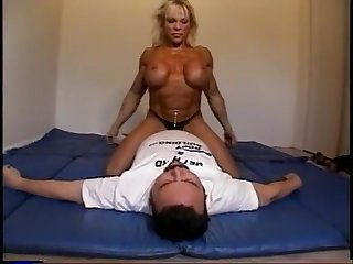 Nude female bodybuilder dominates male down scissors, facesits, ass smothers and breast
